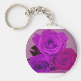 Three roses, tinted purple on a purple back key chains