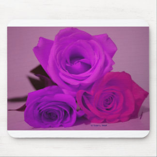 Three roses, tinted purple on a purple back mousepad