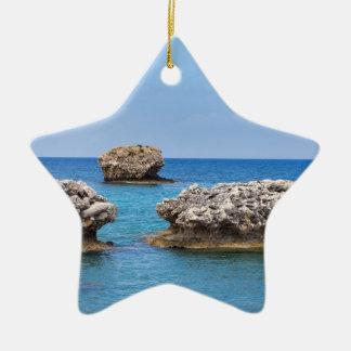 Three separate rocks offshore in sea ceramic ornament