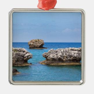 Three separate rocks offshore in sea metal ornament