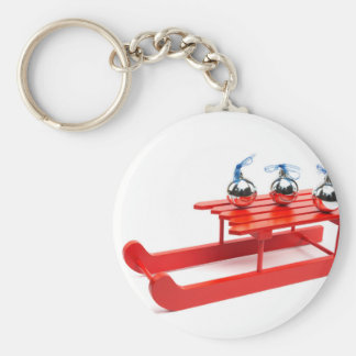 Three silver christmas balls on red sledge keychain