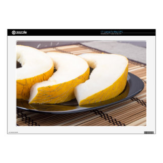 Three slices of juicy yellow melon laptop decal
