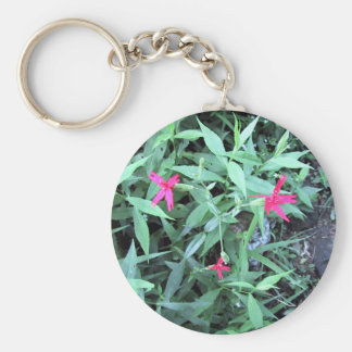 Three small pink flowers keychains