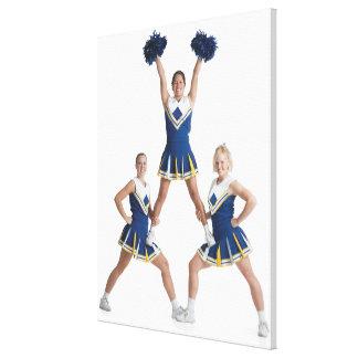 three teenage caucasian female cheerleaders in canvas print