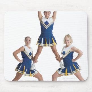 three teenage caucasian female cheerleaders in mouse pad