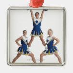 three teenage caucasian female cheerleaders in ornaments