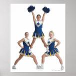 three teenage caucasian female cheerleaders in print