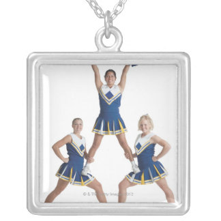 three teenage caucasian female cheerleaders in silver plated necklace