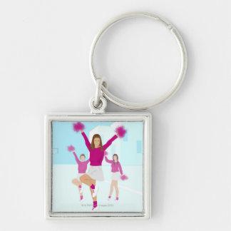 Three teenage cheerleaders holding pom poms 2 keychain