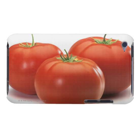 Three tomatoes on counter, close-up iPod touch case