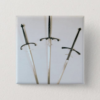 Three two-handed swords, 1570 button