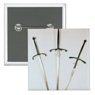 Three two-handed swords, 1570 pinback buttons