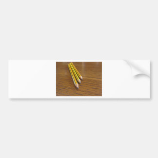 Three used pencils on wooden table bumper sticker