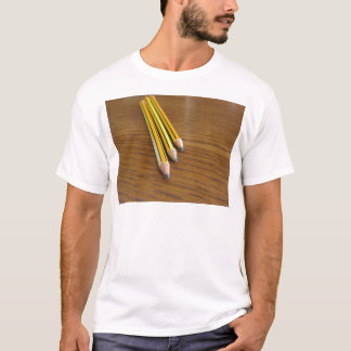 Three used pencils on wooden table T-Shirt