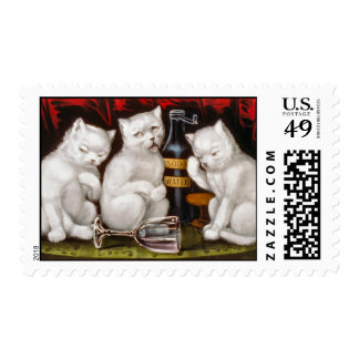Three white kittens with hangovers postage stamp