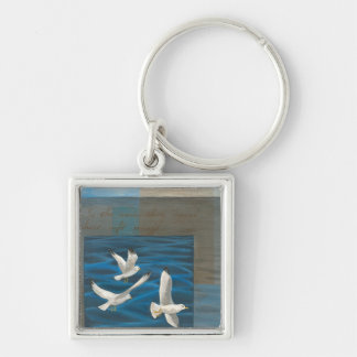 Three White Seagulls Flying Over the Water Keychains