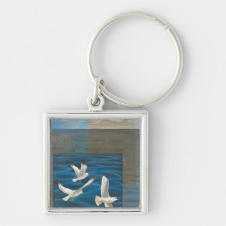 Three White Seagulls Flying Over the Water Key Chains