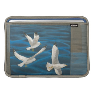 Three White Seagulls Flying Over the Water MacBook Air Sleeve