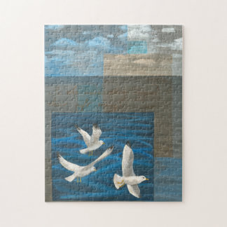 Three White Seagulls Flying Over the Water Jigsaw Puzzle