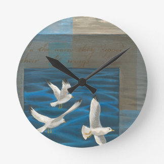 Three White Seagulls Flying Over the Water Round Clock