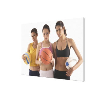 three women of different race, holding canvas print