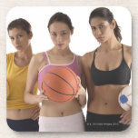 three women of different race, holding coaster