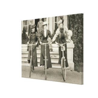 Three women on bicycles, early 1900s (b/w photo) canvas prints