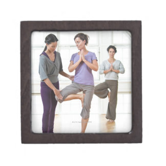 Three women practicing yoga keepsake box
