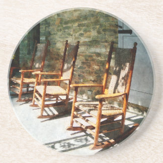Three Wooden Rocking Chairs on Sunny Porch Drink Coaster
