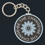 "Three Word Quotes ~Be The Change~ Keychain<br><div class=""desc"">&quot;Be the change &quot; is a great 3 word quote to inspire yourself.Three word quotes are wonderful words to motivate and inspire oneself. They act as tools of encouragement to stay optimistic,  motivated and focused. They are great to use as affirmations for daily encouragement.</div>"