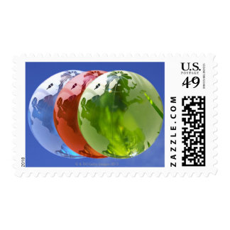 Three world globes showing the Americas and Postage Stamps