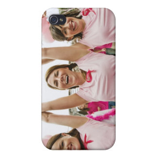 Three young women dressed in pink run in iPhone 4/4S covers