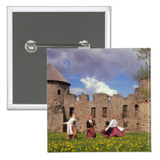 Three young women in traditional clothes 2 inch square button