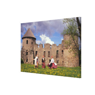Three young women in traditional clothes canvas print