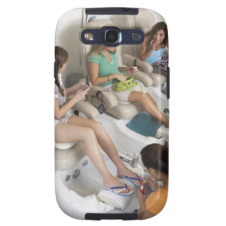 Three young women receiving pedicure in beauty samsung galaxy SIII covers