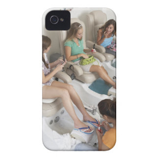 Three young women receiving pedicure in beauty iPhone 4 Case-Mate case