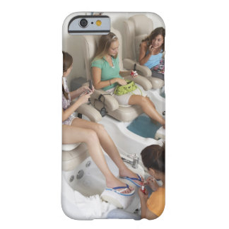 Three young women receiving pedicure in beauty iPhone 6 case