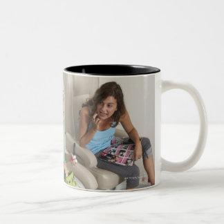 Three young women receiving pedicure in beauty Two-Tone coffee mug