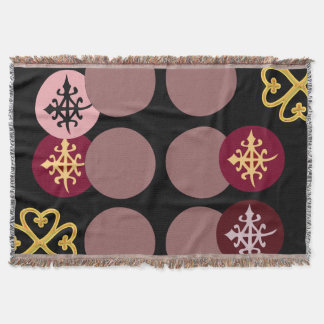Throw blanket symbolic designs from West Africa.