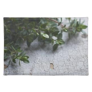 Thyme on old wooden table placemat