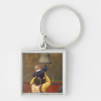 Tibetan Buddhist monk lifting a boy to ring a Silver-Colored Square Keychain
