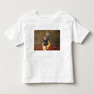 Tibetan Buddhist monk lifting a boy to ring a Toddler T-shirt