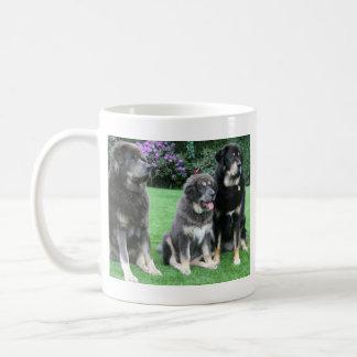 Tibetan Mastiff Puppy with adults Coffee Mug