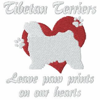 Tibetan Terriers Leave Paw Prints