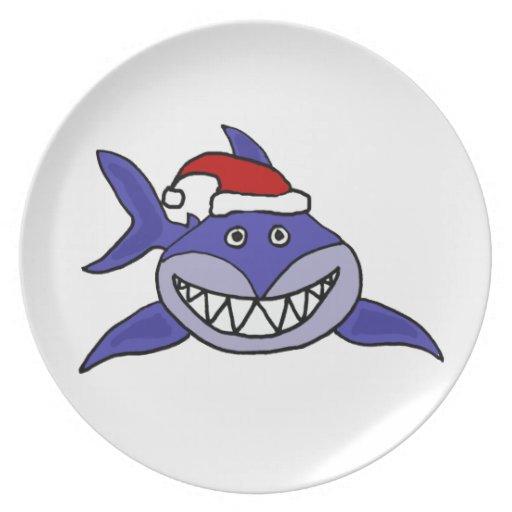 Tiburón sonriente que lleva arte del navidad del g platos