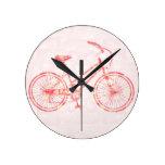 Tic Tac - Monte una bici - rosa Relojes De Pared
