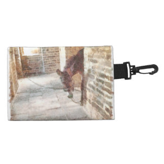 Tied donkey in brick structure accessories bags
