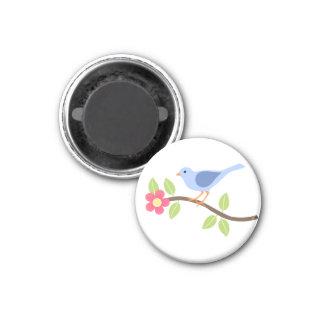 Tiempo de primavera con el pájaro en el imán flore