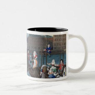 Tienda de los pescados y barco del lavadero en el taza de café de dos colores