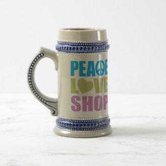 Tienda del amor de la paz jarra de cerveza
